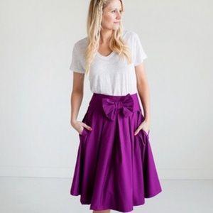 Ampersand Ave • purple midi bow skirt